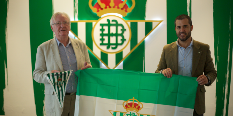 Mario Mendoza et al. standing in front of a box