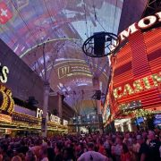 A crowd of people with Fremont Street Experience in the background