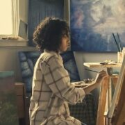 A girl sitting in front painting
