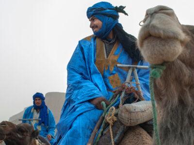A man sitting on camel