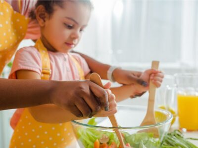 a girl and kid preparing for cooking